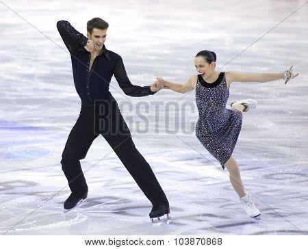 BARCELONA - DEC, 11: Betina Popova and Yuri Vlasenko from Russia during Junior Pairs Ice Dance event of ISU Grand Prix of Figure Skating Final 2014 at CCIB on December 11, 2014 in Barcelona, Spain