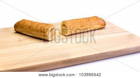Two Pieces Of An Almond Bar On A Wooden Plate
