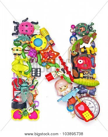 the letter    N  made from small toys