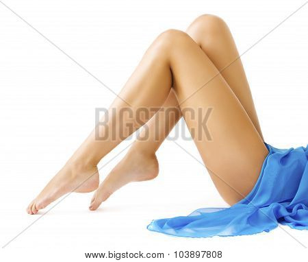 Woman Legs Body Beauty, Slim Leg Smooth Skin, Girl in Blue Dress Lying on White background poster