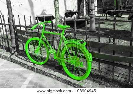 Vibrant green bicycle on the gray background. ecology concept