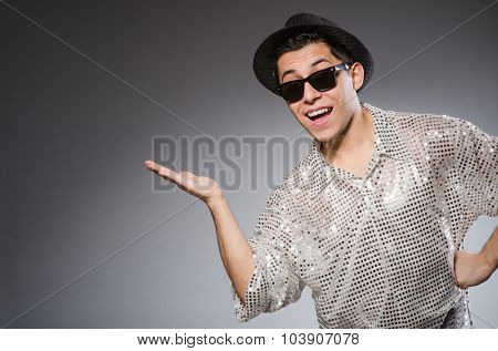 Young man in silver shirt and hat isolated on white