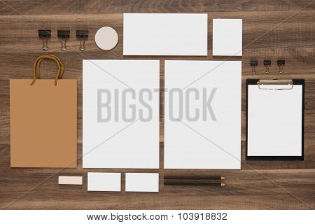 Group of stationery with shopping bag and business cards.
