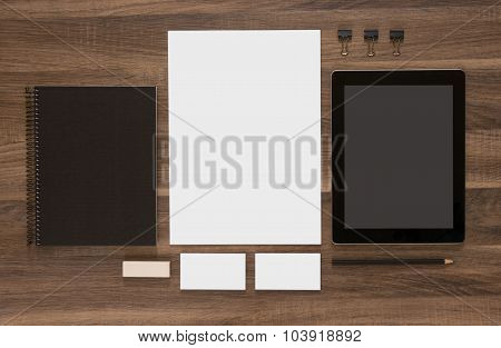 Group of stationery with tablet and business cards.