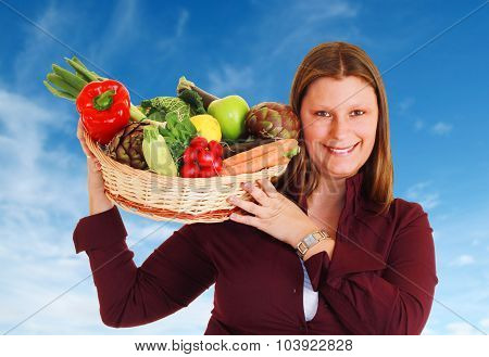 Girl With A Basket Full Of Vegetables