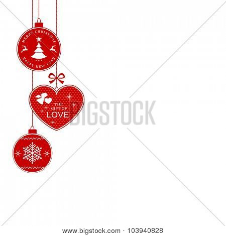 Hanging Christmas balls and heart with the writing Merry Christmas and Happy New Year and The Gift of Love for the festive season to come.