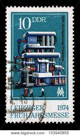 GDR - CIRCA 1974: a stamp printed in GDR shows Power Testing Station, Leipzig Fair, circa 1974