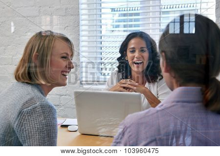 happy business financial advisor woman meeting with couple clients to discuss financial services