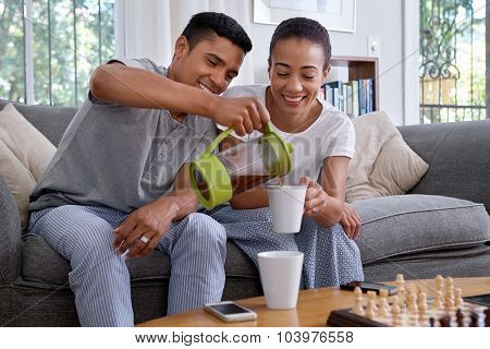 husband pouring coffee early morning breakfast routine in home living room lounge poster