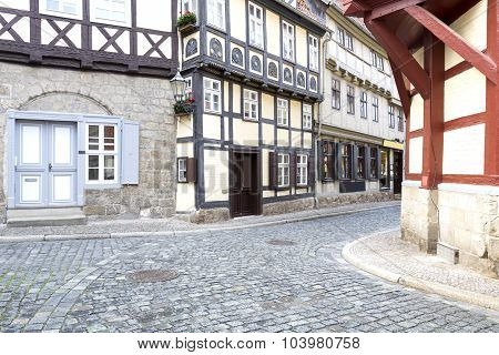 Alleay with half-timbered houses in Quedlinburg town, Germany poster