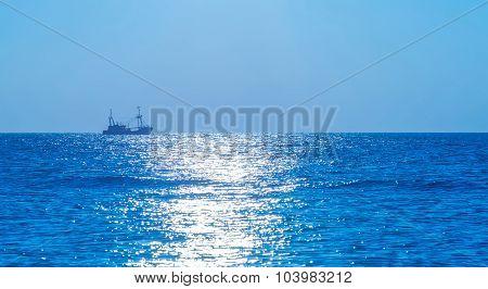 Trawler fishing in moonlight at sea in autumn
