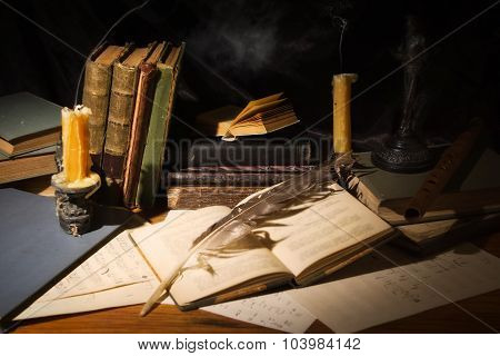 Old Books And Candles On Wooden Table