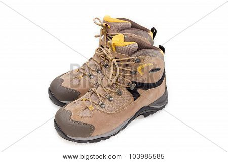 Light Brown Trekking Shoes On A Light Background