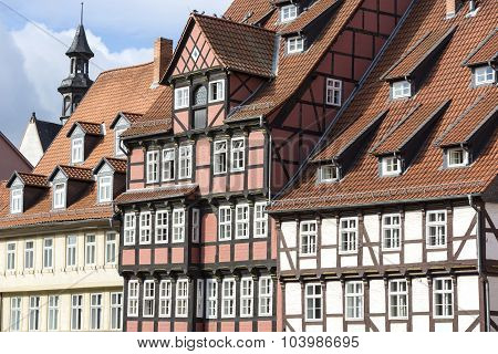 Facades of half-timbered houses in Quedlinburg town, Germany poster