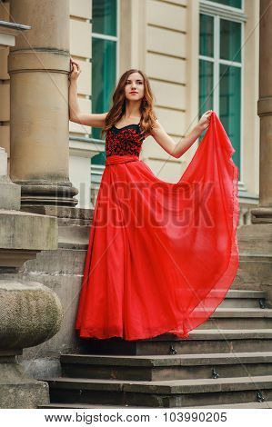 Beautiful Young Woman In Red Dress With Corset