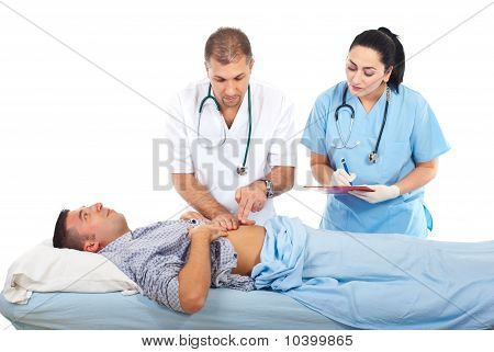 Doctor Examine Patient In Hospital Bed