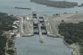 Cargo ships passing through Gatun Locks on the Atlantic side of the Panama Canal poster