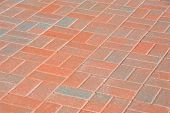 pattern of orange and tan bricks in a patio or walkway poster