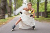 A beautiful runaway bride on roller skates poster
