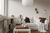 Image of solid and functional white furniture in new style poster