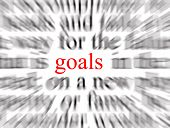 blurred text with a focus on goals poster