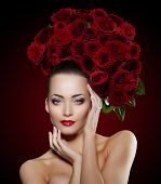 Beautiful model woman rose flower in hair beauty salon makeup Young modern girl in luxurious spa Lady make up Mascara for long lashes lipstick on lips eye shadow shiny hair Products Treatment poster