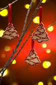 Christmas cookies as tree decoration with a red gold back fround poster