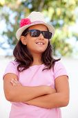 Nice child girl ten year old with a hat on the street poster