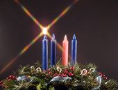 advent candle. first candle lit during advent represents the candle of hope! poster