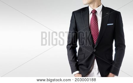 Business concept - confident modern business man with dark suit stand and think the business plan isolated on grey background.