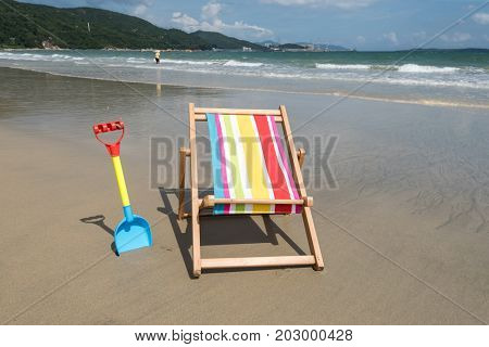 shovel with Deck chair at the tropical beach