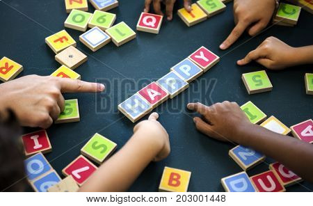 Kindergarten kids playing wooden alphabets letters vocabulary game