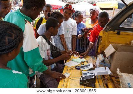 Man Sell Cellular Phones On Rural Madagascar Marketplace