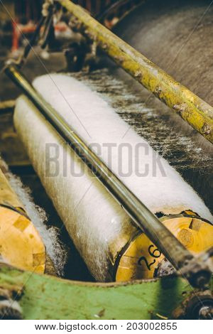 Manufacturing wool filler for the blankets. Machine or machine tool in the workshop production of blankets
