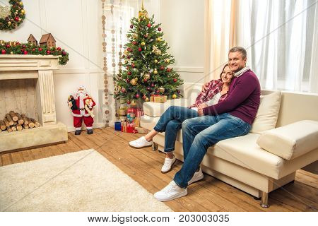 Happy Couple At Christmas Eve