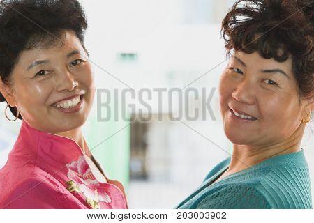 Chinese women smiling