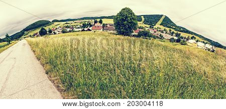 Panoramic photo of Cicmany village Slovak republic. Folklore theme. Rural landscape. Travel destination. Retro photo filter.
