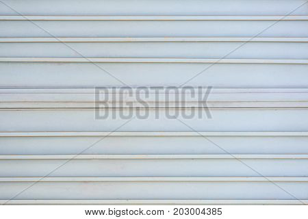 Metal gate painted with gray paint reinforced with rods as background