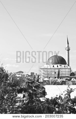 Restoration of Muslim mosque in the old city of Akko. Al-Jazzar mosque as fine example of the Ottoman architecture in old Acre Israel. Black and white picture