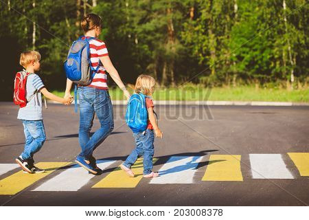Mother with two kids going to school or daycare