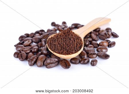 ground coffee and roasted coffee beans arabica strong blend on white background