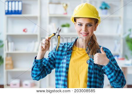Woman in workshop with pliers