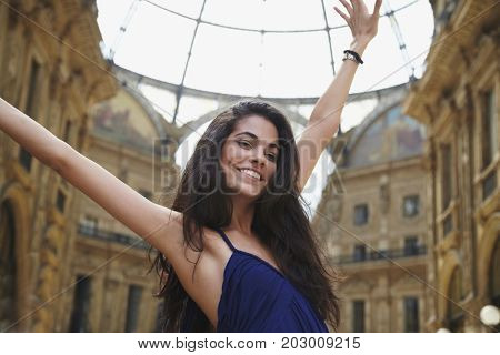 Brazilian woman standing in plaza