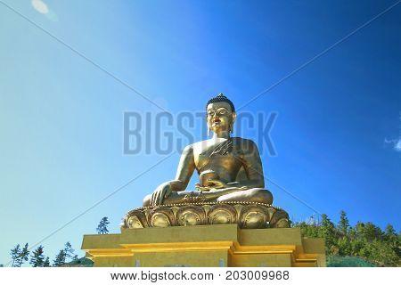 Buddha Dordenma statue on blue sky background Giant Buddha Thimphu Bhutan