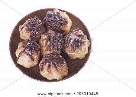 Chocolate cream puff isolated on white background