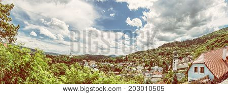 Panoramic photo of Banska Stiavnica with New castle and Old castle Slovak republic. Travel destination. Beautiful urban landscape. Yellow photo filter.