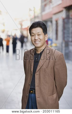 Chinese man on city street