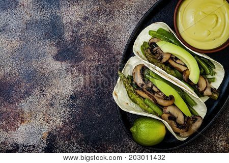 Grilled portobello asparagus bell peppers green beans fajitas. Poblano mushroom tacos with jalapeno cilantro avocado crema. Vegan tacos with green summer vegetables. Copy space