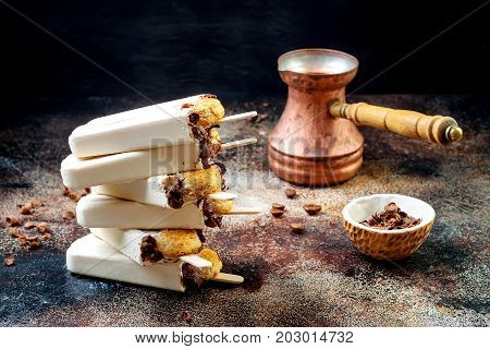 Tiramisu popsicles. Ice pops with italian savoiardi cookies and tiramisu ingredients on rustic kitchen table.