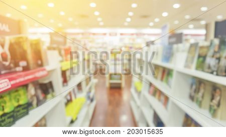 BLUR IMAGE OF THE BOOKSTORE WITH FLARE EFFECT